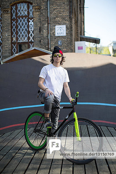 Portrait of male cyclist at city velodrome  Riga  Latvia