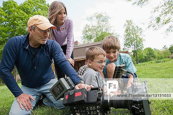 Film maker showing HD camera to kids