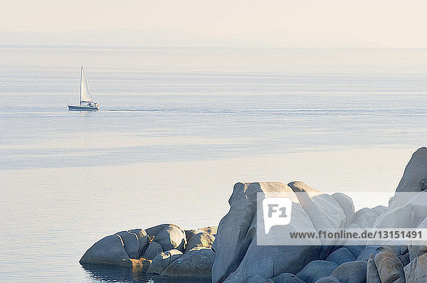 View of coastal rocks and yacht  Corsica  France View of coastal rocks and yacht, Corsica, France