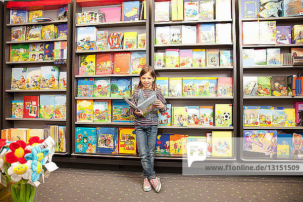 Girl reading in front of a bookcase