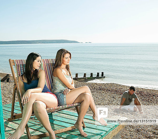 Friends relaxing at the beach