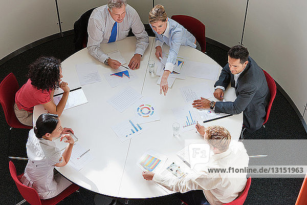 Business colleagues working together in meeting room  high angle view