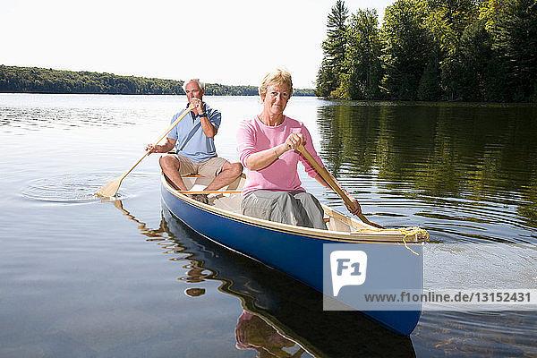 Senior couple in canoe