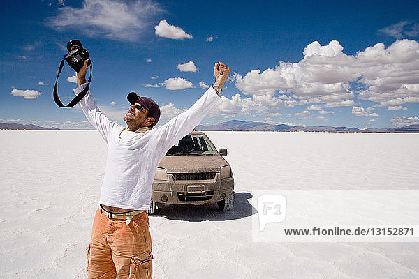 Photographer celebrates in a salt field  Salinas Grandes  Cordoba Province  Argentina