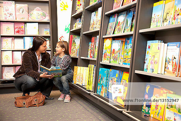 Mother and daughter in a book store