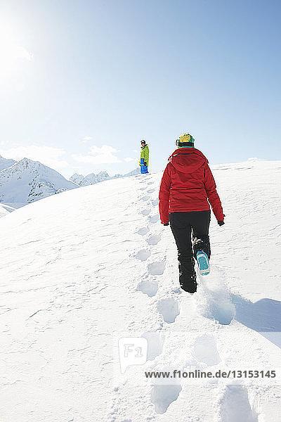 Two people walking in snow  Kuhtai  Austria