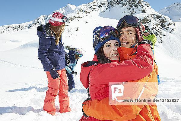 Friends wearing skiwear hugging  Kuhtai  Austria