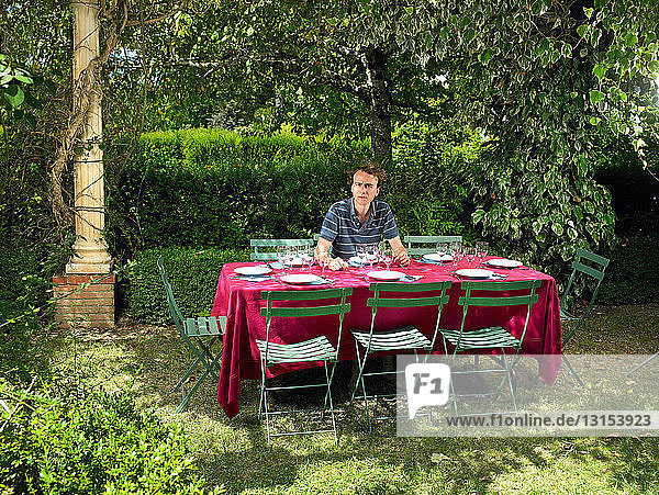 Man at table  waiting for his friends
