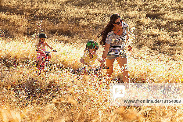 Mother and daughters cycling  Mt Diablo State Park  California  USA