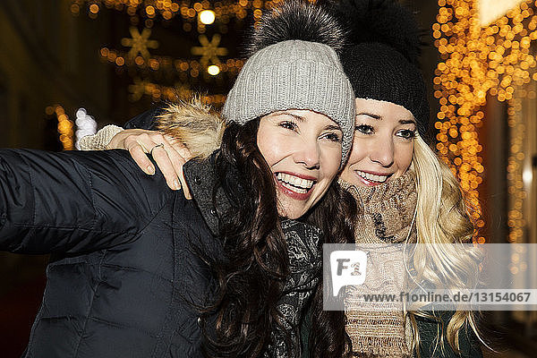 Two mid adult women wearing hats  smiling