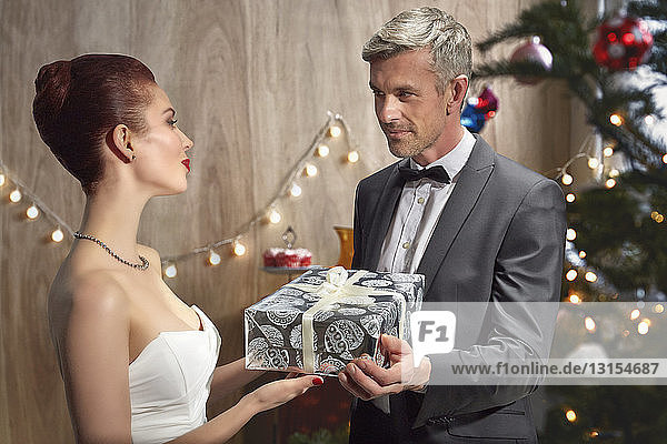 Husband and wife with Christmas gift