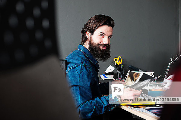 Young man with beard at desk