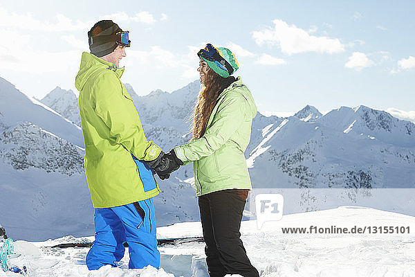 Couple holding hands with mountains in background  Kuhtai  Austria