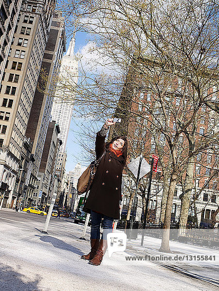 Woman with camera in Manhattan