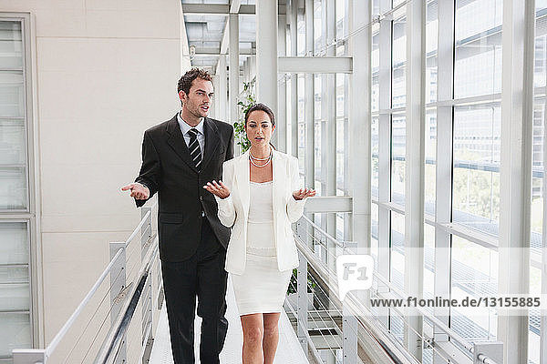 Business couple in corridor