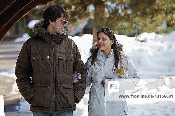 Couple in casual ski wear.