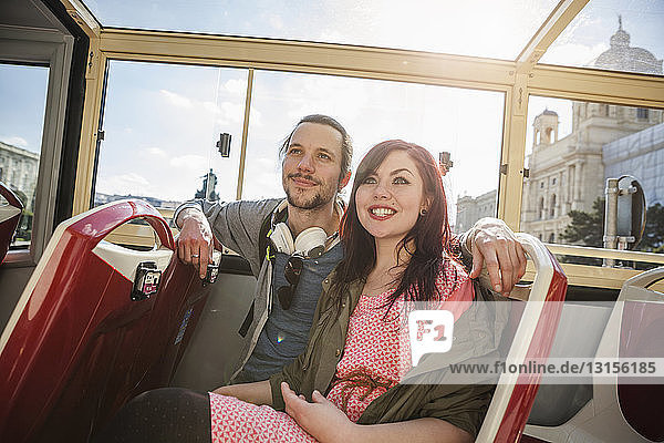 Young adult couple on bus