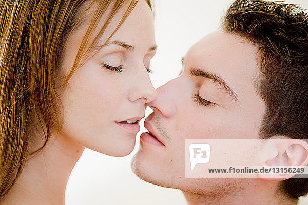 Young couple hugging and kissing