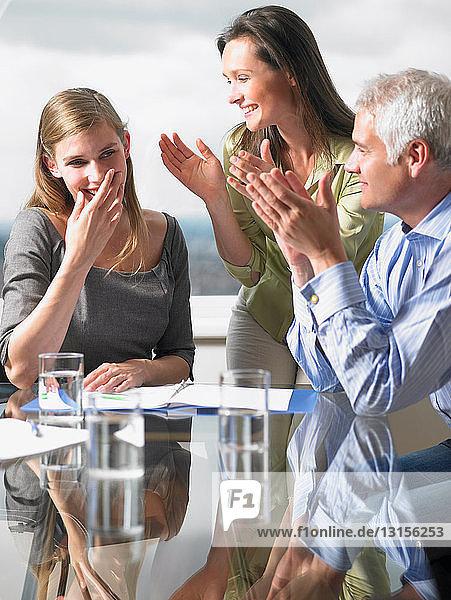 Business partners applauding