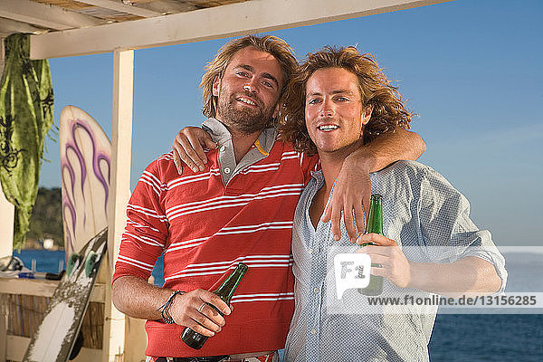 surf men drinking beer surf men drinking beer