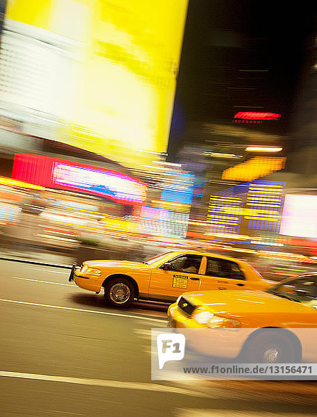Taxicabs in motion  New York City  USA