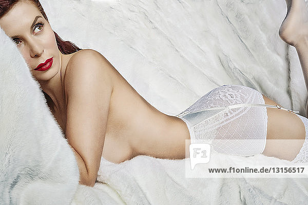 Close up of woman in white lingerie