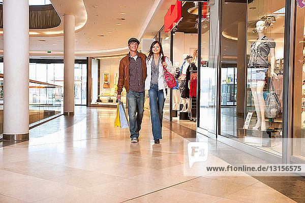 Young couple walking in shopping mall