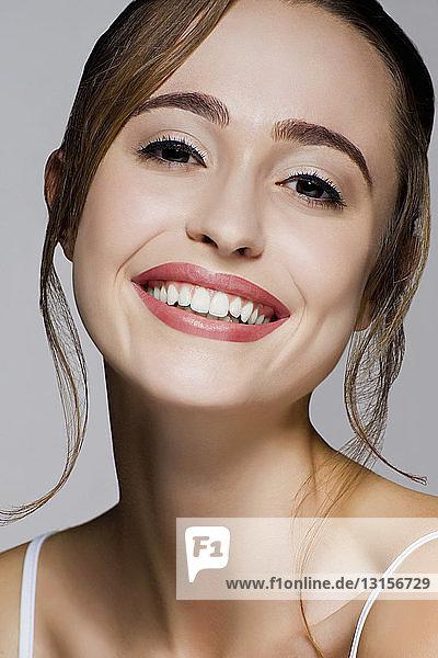 Studio portrait of young beautiful smiling woman Studio portrait of young beautiful smiling woman