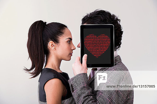 Man holding digital tablet with heart shape Man holding digital tablet with heart shape
