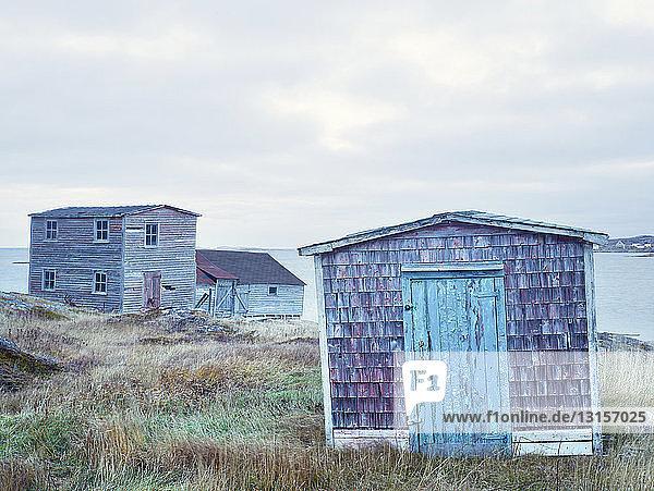 Huts by ocean  Fogo Island  Newfoundland  Canada Huts by ocean, Fogo Island, Newfoundland, Canada