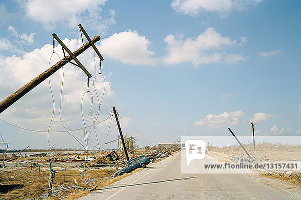 Fallen telephone poles and crashed car  aftermath of Hurricane Katrina  Cameron  Louisiana. USA