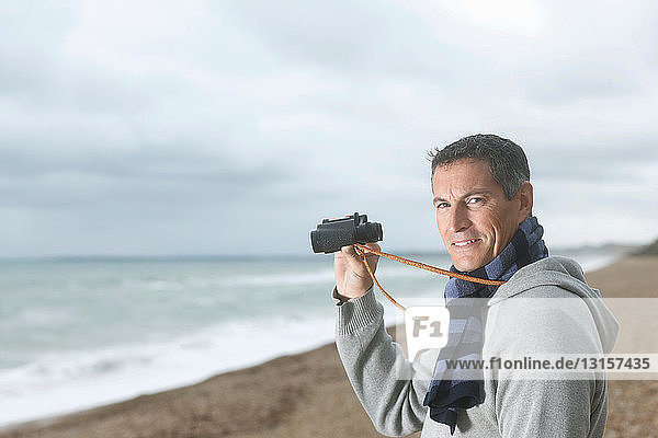 Man with Binoculars on Beach