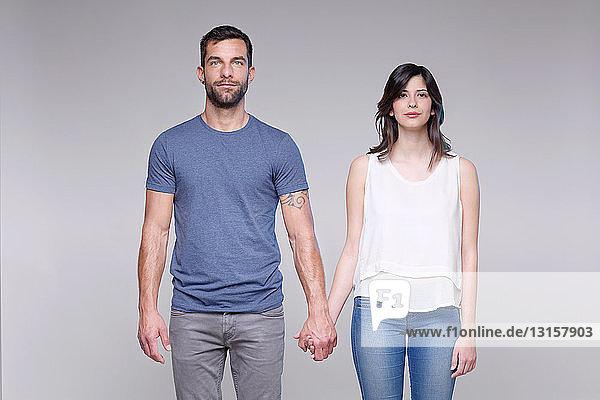 Portrait of heterosexual couple holding hands