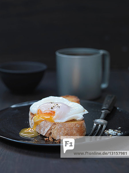 Close up of poached egg on toast Close up of poached egg on toast