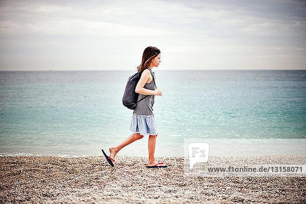 Girl walking by the sea Girl walking by the sea