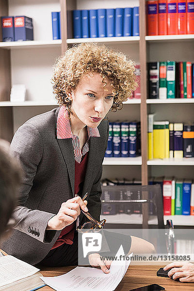 Female lawyer explaining in meeting