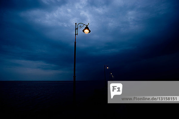 Streetlights along pier at night