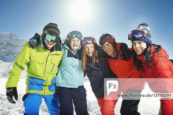 Friends wearing skiwear with arms around each other  Kuhtai  Austria