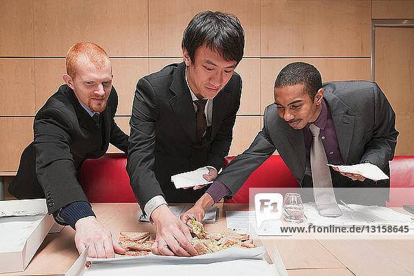 3 young businessman choosing sandwiches