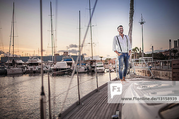 Young man relaxing on yacht  Cagliari  Sardinia  Italy