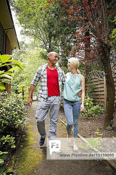 Happy couple strolling in garden