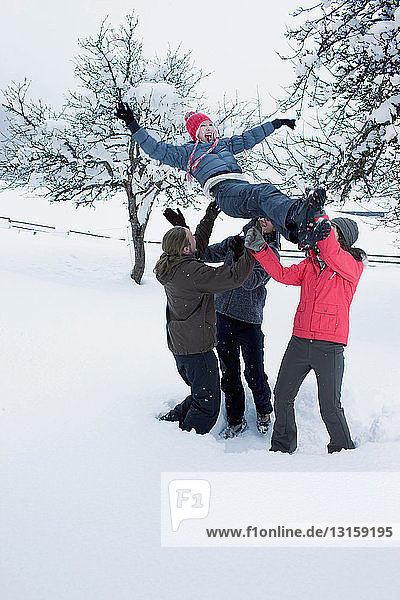 Young people having fun in the snow