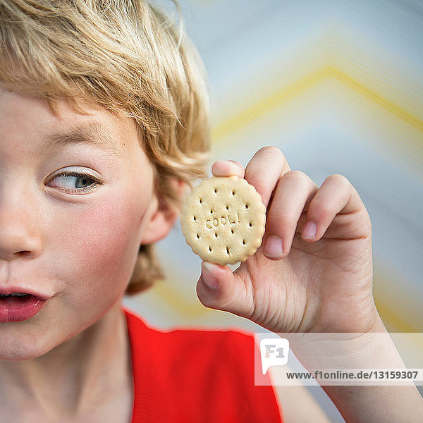 Boy holding cool biscuit