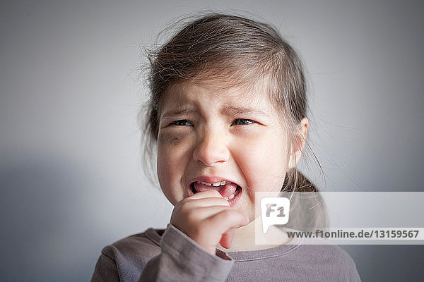 Girl with black eye crying