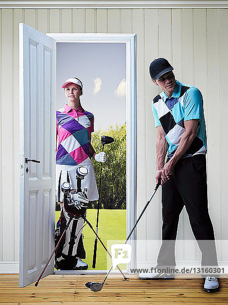 Couple playing golf in new home