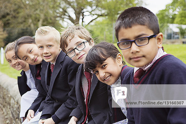 Group of young classmates in playground