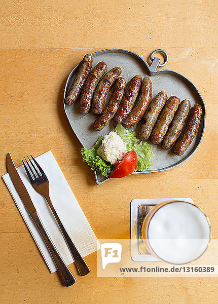 Table with sausages on heart shape tray  Nuremberg  Germany Table with sausages on heart shape tray, Nuremberg, Germany