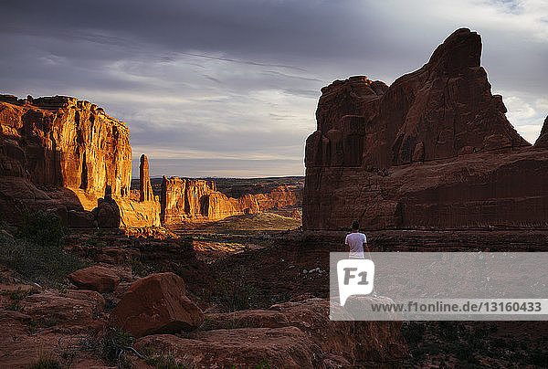 Man standing in Park Avenue at dawn  Arches National Park  Utah  USA