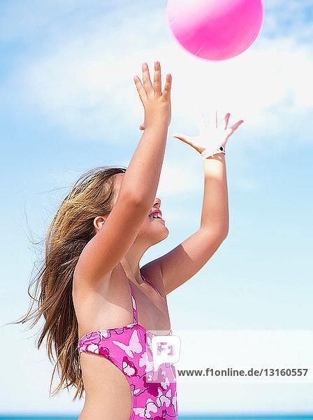 young girl playing ball