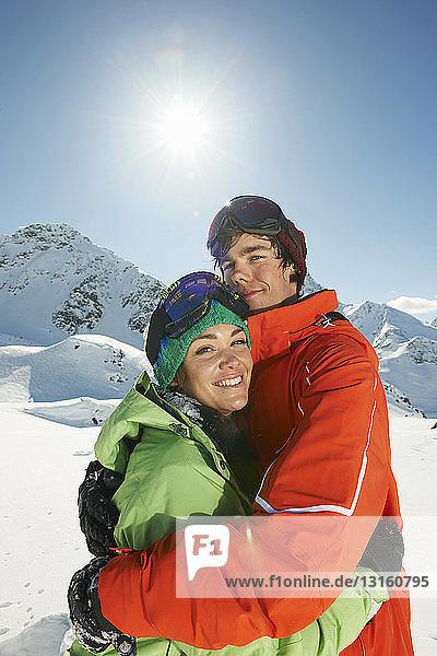 Couple wearing skiwear hugging  Kuhtai  Austria
